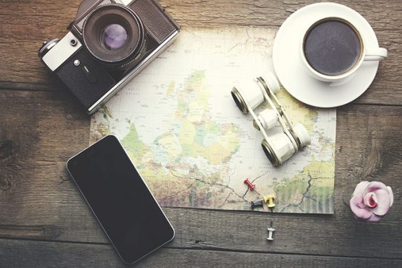 travel items -binocular, map, coffee, camera and phone